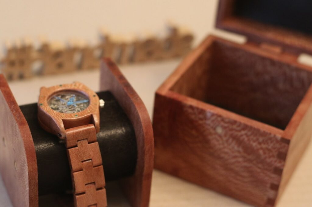 image shows a watch and wooden box